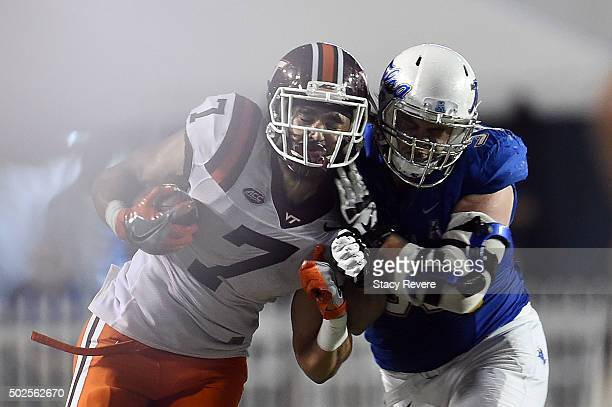 Bucky Hodges of the Virginia Tech Hokies is hit by Derrick Luetjen of the Tulsa Golden Hurricane during the second half of the Camping World...