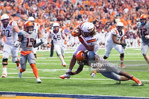 Bucky Hodges of the Virginia Tech Hokies runs into the end zone for a touchdown that would tie the game during the fourth quarter against the...