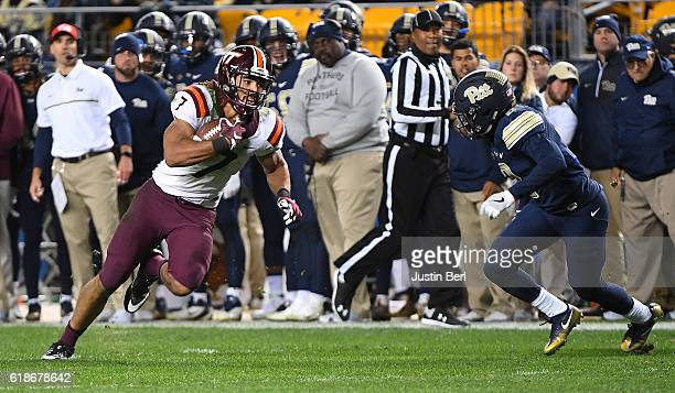 Bucky Hodges of the Virginia Tech Hokies runs up field after a reception in the second half during the game against the Pittsburgh Panthers at Heinz...