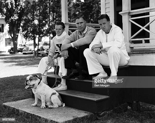 Bucky M Byers coxswain Coach Ed Leader and Henry Ford II manager all of the Yale crew team with their mascot dog 'Handsome Dan V' New London CT c 1940