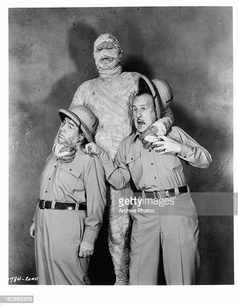 Bud Abbott and Lou Costello are startled by a mummy in publicity portrait for the film 'Abbott And Costello Meet The Mummy' 1955