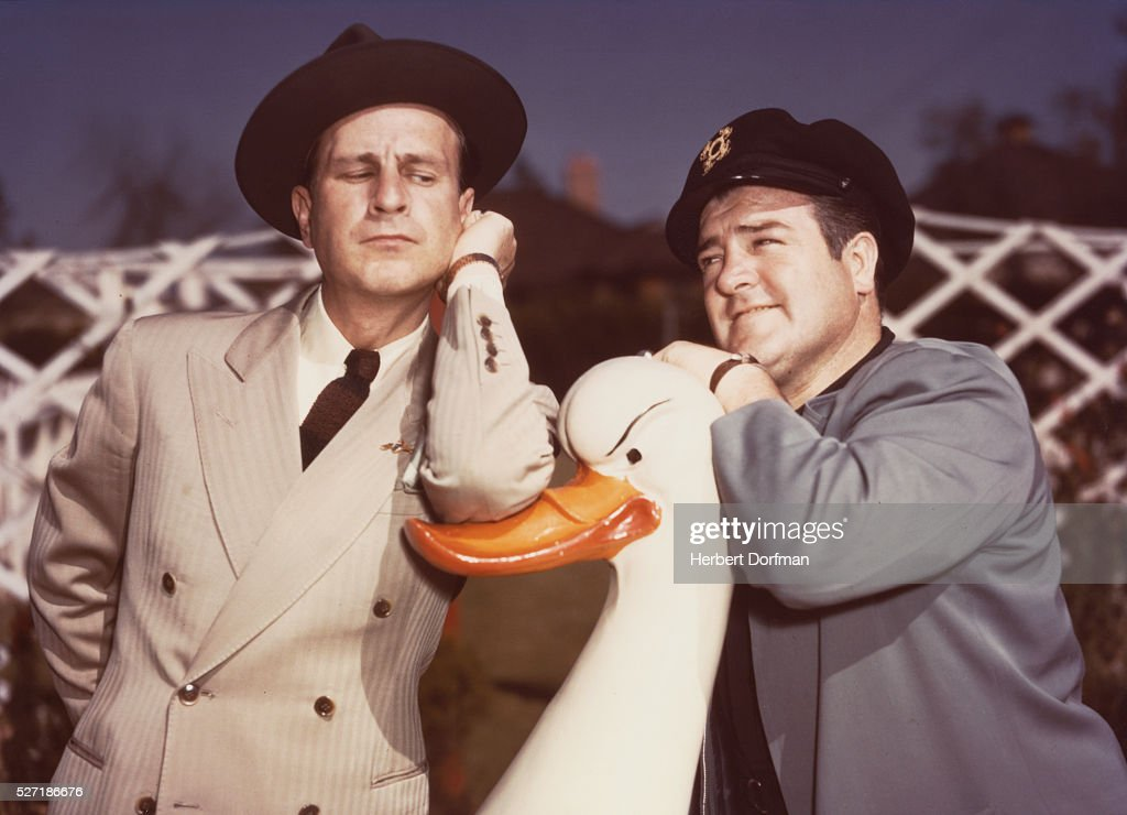 <a gi-track='captionPersonalityLinkClicked' href=/galleries/search?phrase=Bud+Abbott&family=editorial&specificpeople=228402 ng-click='$event.stopPropagation()'>Bud Abbott</a> and <a gi-track='captionPersonalityLinkClicked' href=/galleries/search?phrase=Lou+Costello&family=editorial&specificpeople=123845 ng-click='$event.stopPropagation()'>Lou Costello</a> Leaning on a Duck Sculpture