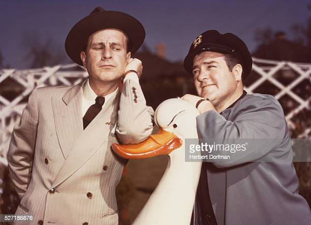 Bud Abbott and Lou Costello Leaning on a Duck Sculpture