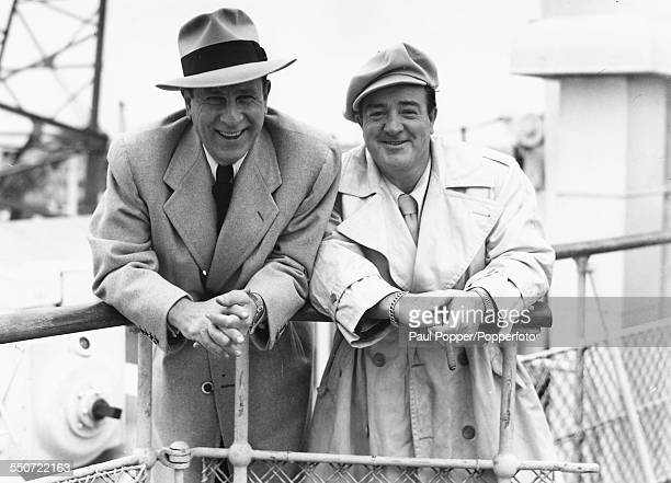 Bud Abbott and Lou Costello of American comedy double act Abbott and Costello pictured together smiling on the deck of a ship as they arrive from the...