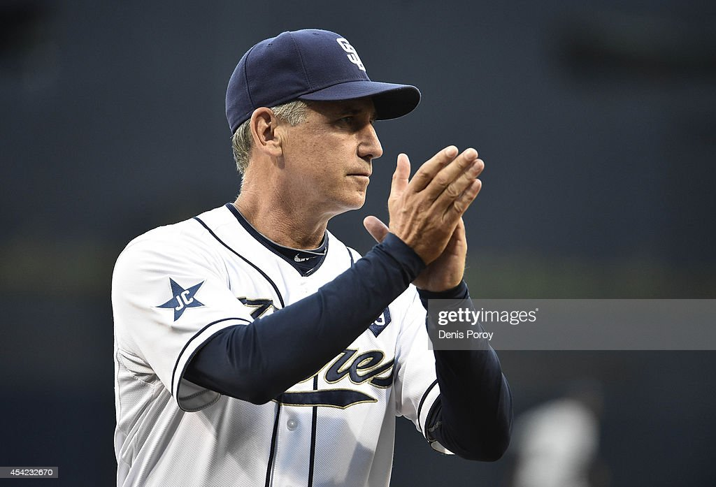 Bud Black manager of the San Diego Padres claps during a ceremony before a baseball game against the Milwaukee Brewers at Petco Park August 2014 in...