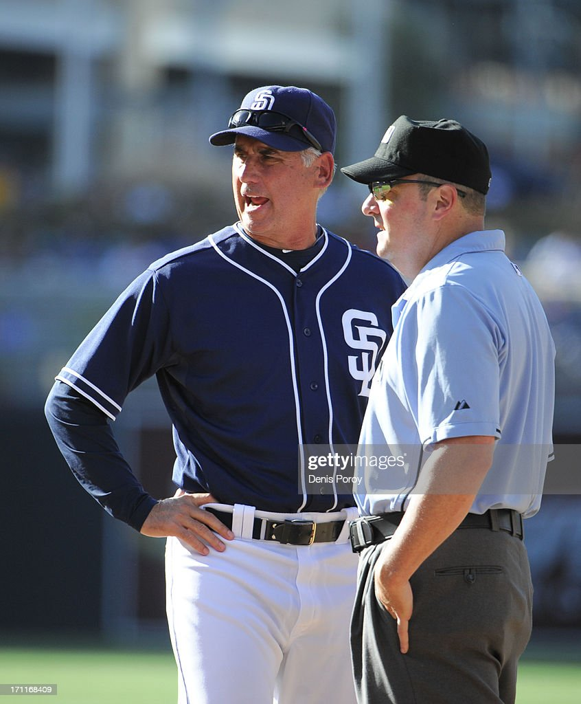 Bud Black #20 of the San Diego Padres argues a call with umpire Marty Foster during the fifth inning of a baseball game against the Los Angeles Dodgers at Petco Park on June 22, 2013 in San Diego, California.