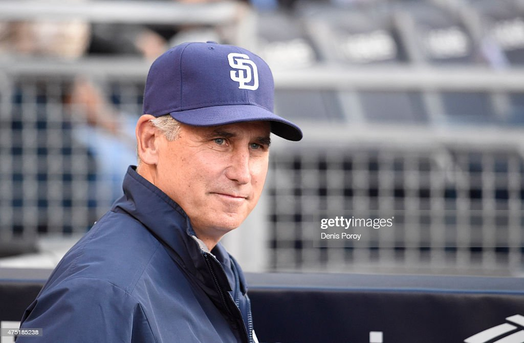 Bud Black of the San Diego Padres sits in the dugout before a baseball game against the Pittsburgh Pirates at Petco Park May 28 2015 in San Diego...
