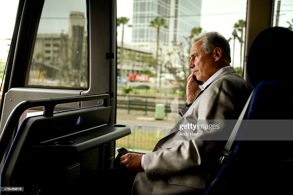 Bud Black of the San Diego Padres talks on his phone on the team bus ride to the airport on a travel day to Cincinnatti Ohio on June 4 2015 in San...