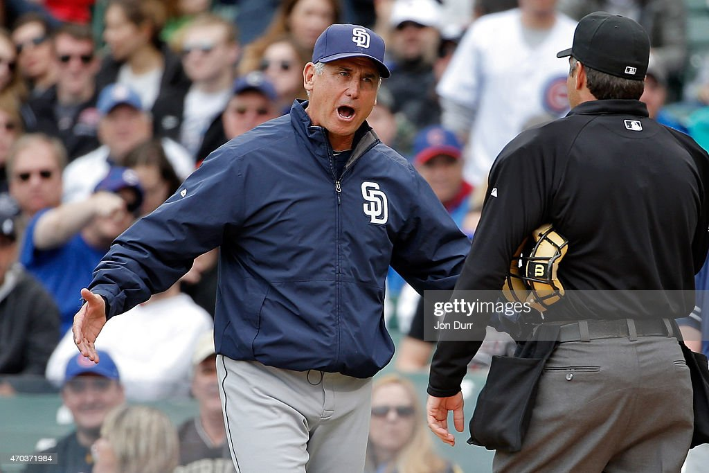 Bud Black of the San Diego Padres talks to umpire James Hoye after being thrown out of the game against the Chicago Cubs during the second inning on...
