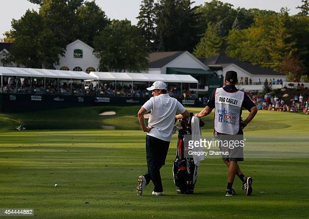 Bud Cauley and his caddie Mike Bester wait in the 18th fairway during the final round of the Webcom Tour Hotel Fitness Championship at Sycamore Hills...