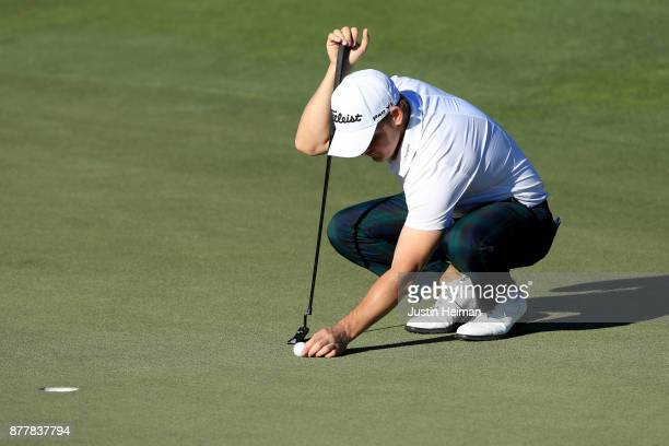 Bud Cauley of the United States lines up a putt on the 18th green during the final round of The RSM Classic at Sea Island Golf Club Seaside Course on...