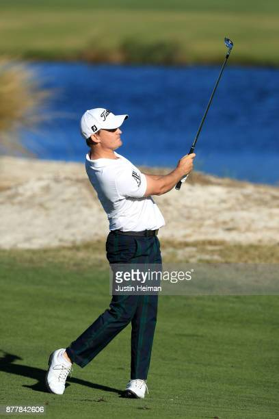 Bud Cauley of the United States plays his second shot on the 18th hole during the final round of The RSM Classic at Sea Island Golf Club Seaside...