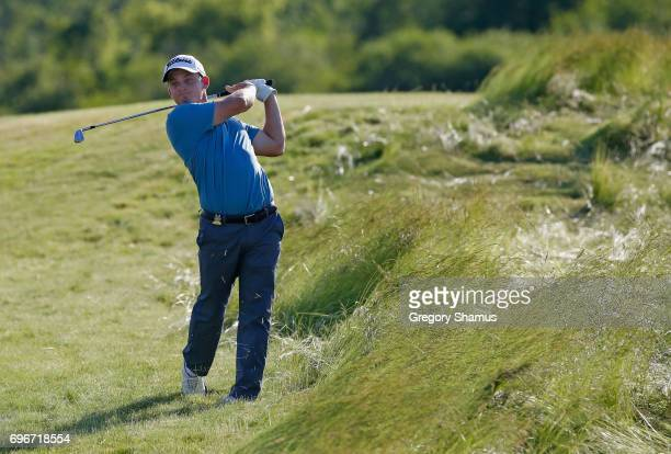Bud Cauley of the United States plays his shot on the 17th hole during the second round of the 2017 US Open at Erin Hills on June 16 2017 in Hartford...