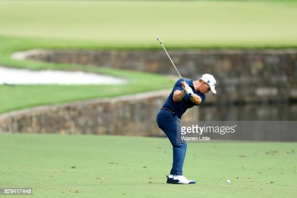 Bud Cauley of the United States plays his third shot on the seventh hole during the first round of the 2017 PGA Championship at Quail Hollow Club on...