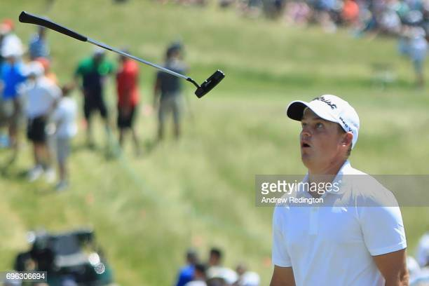 Bud Cauley of the United States reacts after a putt on the seventh green during the first round of the 2017 US Open at Erin Hills on June 15 2017 in...