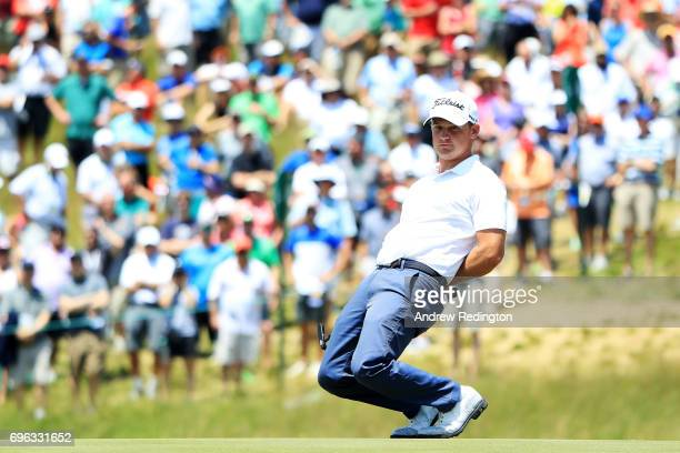 Bud Cauley of the United States reacts after putting on the ninth green during the first round of the 2017 US Open at Erin Hills on June 15 2017 in...