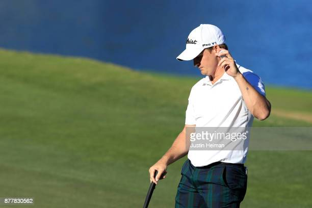 Bud Cauley of the United States waves after putting on the 18th green during the final round of The RSM Classic at Sea Island Golf Club Seaside...