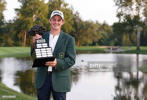 Bud Cauley poses with the Hotel Fitness Championship trophy after posting a final score of 20underpar to win Webcom Tour Hotel Fitness Championship...