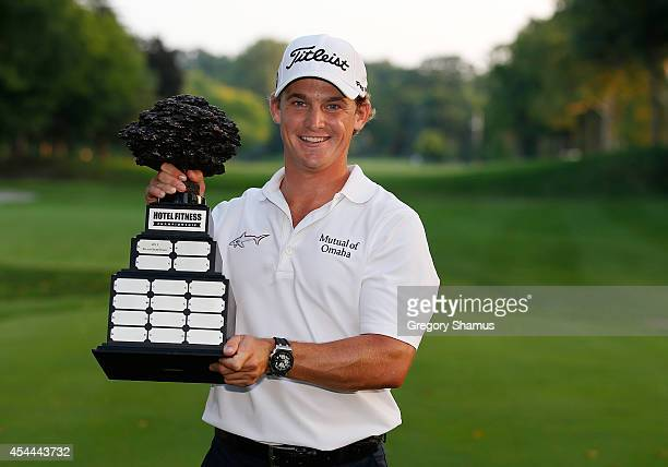 Bud Cauley poses with the Hotel Fitness Championship trophy after posting a final score of 20 to win Webcom Tour Hotel Fitness Championship at...