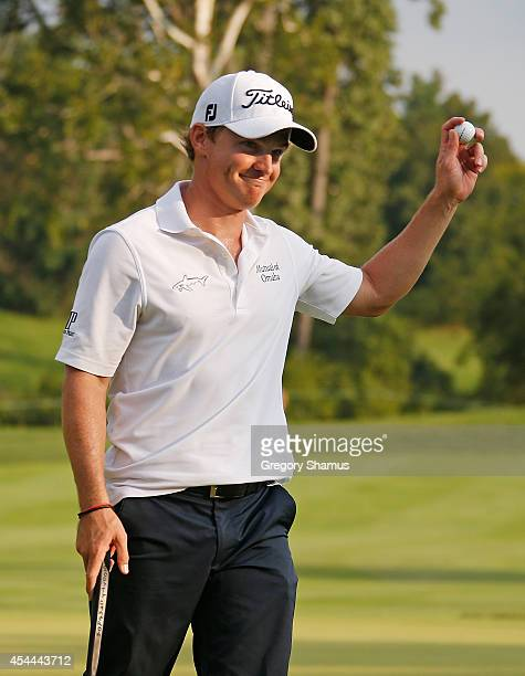 Bud Cauley waves to fans after putting in for par on the 18th green during the final round of the Webcom Tour Hotel Fitness Championship at Sycamore...