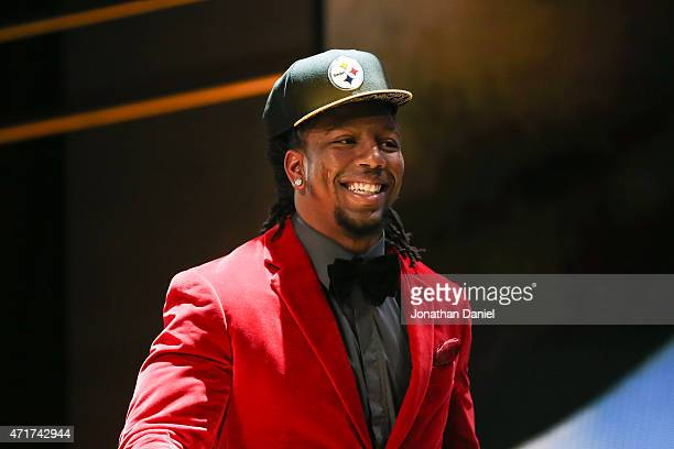 Bud Dupree of the Kentucky Wildcats walks on stage after being picked overall by the Pittsburgh Steelers during the first round of the 2015 NFL Draft...
