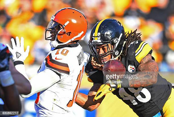 Bud Dupree of the Pittsburgh Steelers causes a fumble by Robert Griffin III of the Cleveland Browns in the second half during the game at Heinz Field...