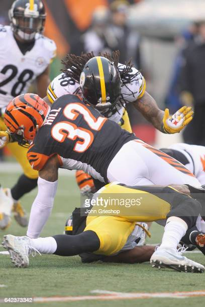 Bud Dupree of the Pittsburgh Steelers makes the tackle on Jeremy Hill of the Cincinnati Bengals during their game at Paul Brown Stadium on December...
