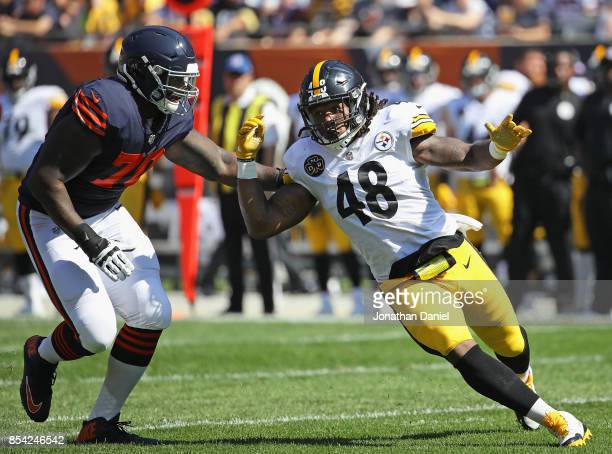 Bud Dupree of the Pittsburgh Steelers ruses against Bobby Massie of the Chicago Bears at Soldier Field on September 24 2017 in Chicago Illinois The...
