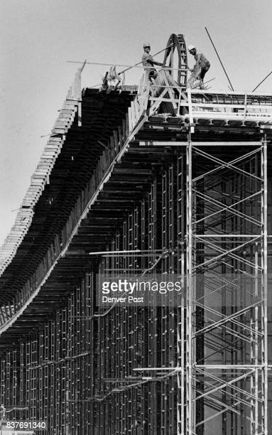 Bud McGee and Don Kreutzer pull tendons through a horseshoe which threads them through ducts build into the bridge bed on Walnut St Viaduct The...