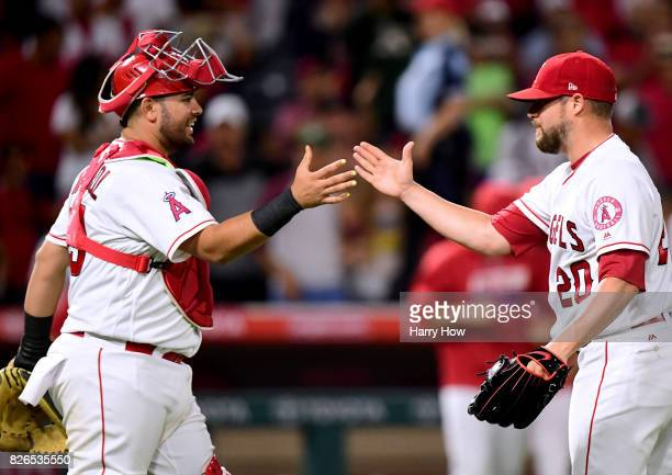 Bud Norris and Juan Graterol of the Los Angeles Angels celebrate an 86 win over the Oakland Athletics at Angel Stadium of Anaheim on August 4 2017 in...