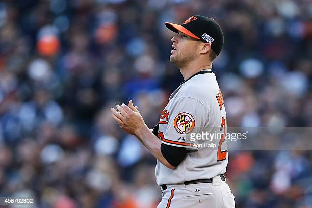 Bud Norris of the Baltimore Orioles looks at the scoreboard in the seventh inning against the Detroit Tigers during Game Three of the American League...