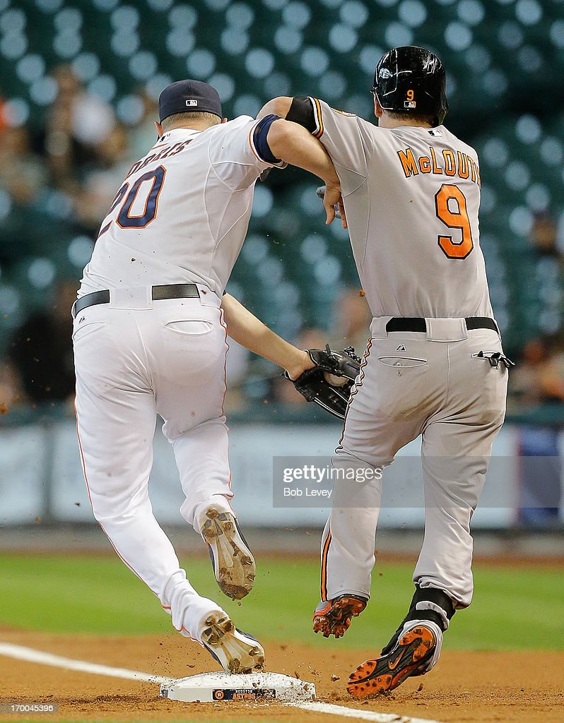 <a gi-track='captionPersonalityLinkClicked' href=/galleries/search?phrase=Bud+Norris&family=editorial&specificpeople=5746311 ng-click='$event.stopPropagation()'>Bud Norris</a> #20 of the Houston Astros beats <a gi-track='captionPersonalityLinkClicked' href=/galleries/search?phrase=Nate+McLouth&family=editorial&specificpeople=536572 ng-click='$event.stopPropagation()'>Nate McLouth</a> #9 of the Baltimore Orioles to the bag for the out in the first inning at Minute Maid Park on June 6, 2013 in Houston, Texas.