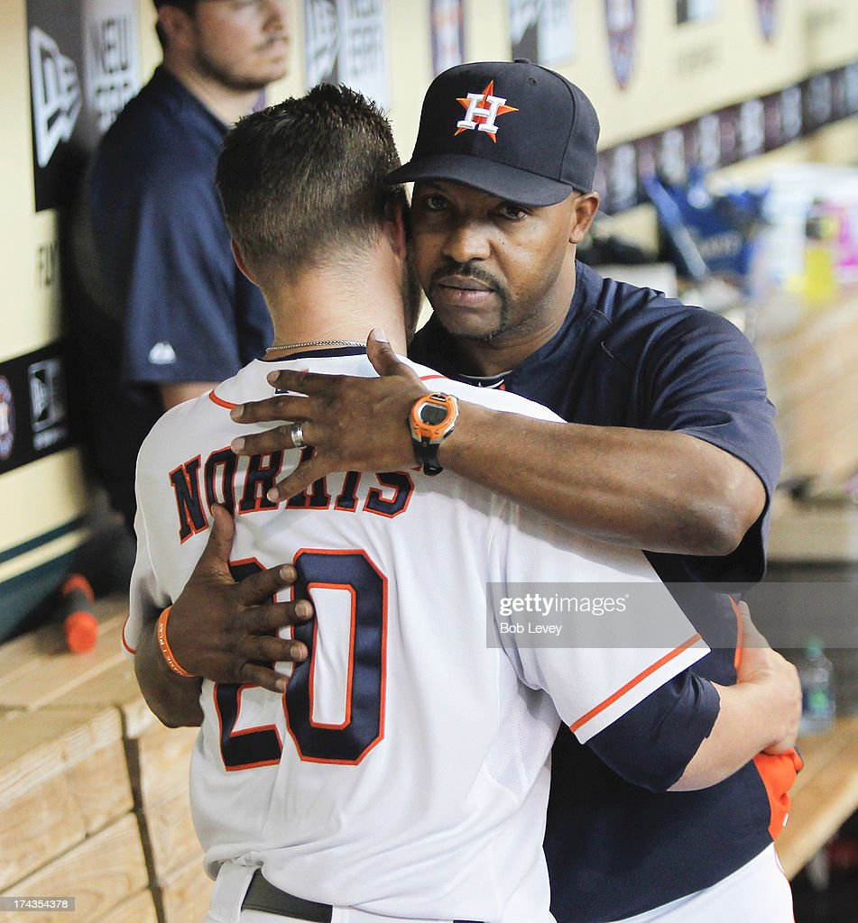 Bud Norris #20 of the Houston Astros gets a hug from manager Bo Porter after being taken out of the game in the seventh inning against the Oakland Athletics at Minute Maid Park on July 24, 2013 in Houston, Texas.
