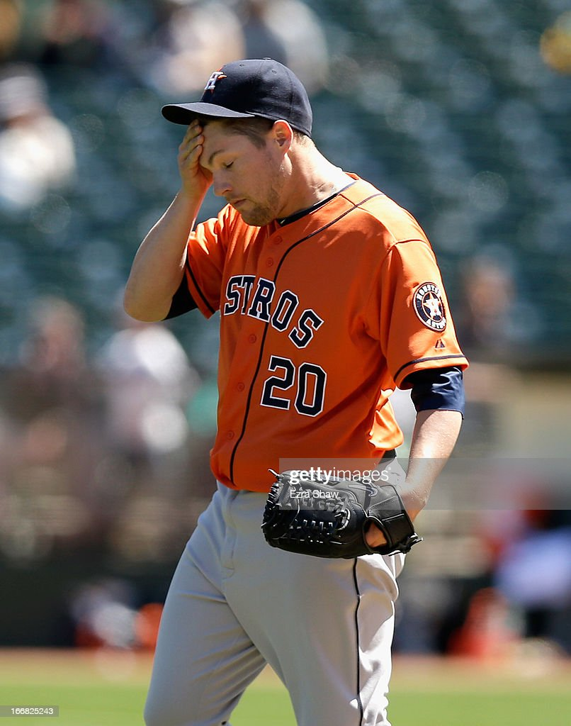 Bud Norris #20 of the Houston Astros wipes his face after he walked Shane Peterson #32 of the Oakland Athletics to load the bases in the first inning at O.co Coliseum on April 17, 2013 in Oakland, California.