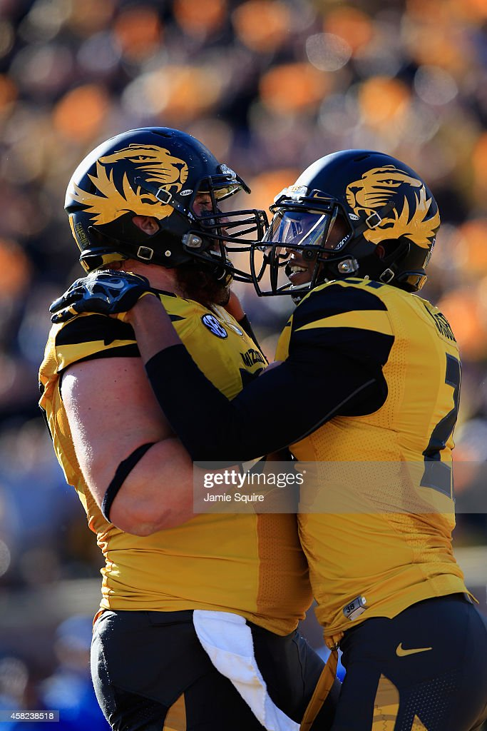 Bud Sasser #21 of the Missouri Tigers is congratulated by <a gi-track='captionPersonalityLinkClicked' href=/galleries/search?phrase=Evan+Boehm&family=editorial&specificpeople=9839229 ng-click='$event.stopPropagation()'>Evan Boehm</a> #77 of the Missouri Tigers after scoring a touchdown during the first half of the game against the Kentucky Wildcats at Faurot Field/Memorial Stadium on November 1, 2014 in Columbia, Missouri.