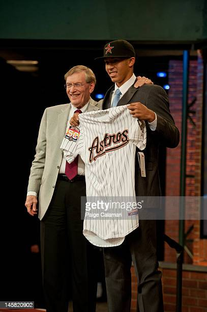 Bud Selig Commissioner of Major League Baseball poses with shortstop Carlos Correa who was drafted out of the Puerto Rico Baseball Academy by the...