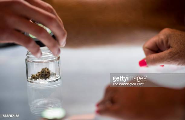 Bud Tender shows a patient a certain type of cannibis at the Blum Medical Marijuana Dispensary just a week after Nevada legalized marijuana and...
