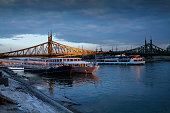 Budapest. Bridge on Danube river and boats.