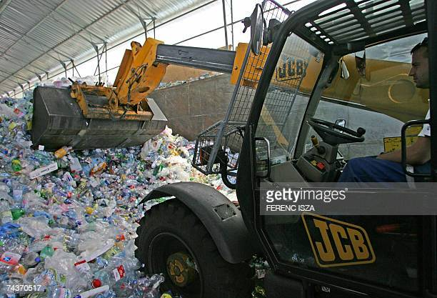 A employee moves plastic 'Pet' bottles collected from the selective waste bins 17 May 2007 at the 'Metaloglobus' Plastic Recycling Company in...