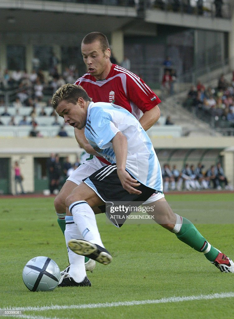 Argentine Andes D'Alessando fights for the ball with Hungarian Laszlo Eger in 'Puskas' stadium in Budapest 17 August 2005 during a friendly match between their national teams.