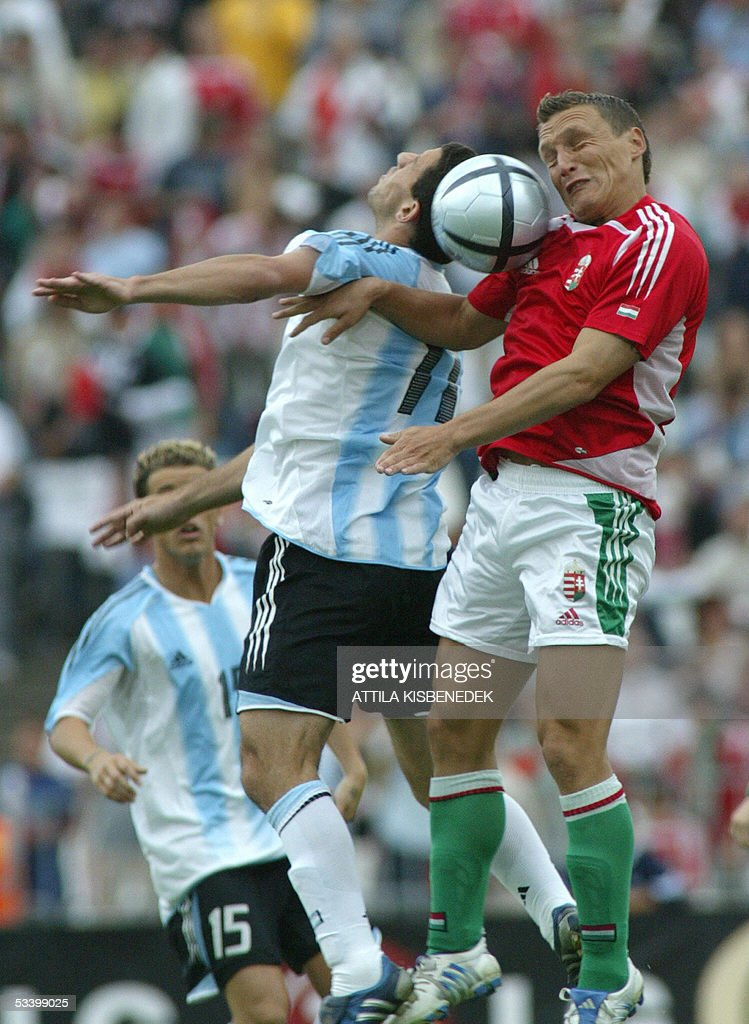 Argentine Maximiliano Rodriguez(L) and Hungarian Laszlo Bodnar head the ball in 'Puskas' stadium in Budapest 17 August 2005 during a friendly match between their national teams.