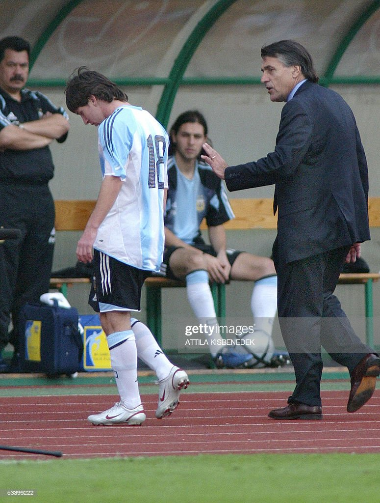 Argentine's Lionel Messi (C) is comforted by his coach Jose Pekerman (R) after receiving a red card at the Puskas stadium in Budapest, 17 August 2005 during the friendly football match Argentine vs Hungary.
