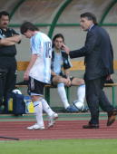 Argentine's Lionel Messi is comforted by his coach Jose Pekerman after receiving a red card at the Puskas stadium in Budapest 17 August 2005 during...