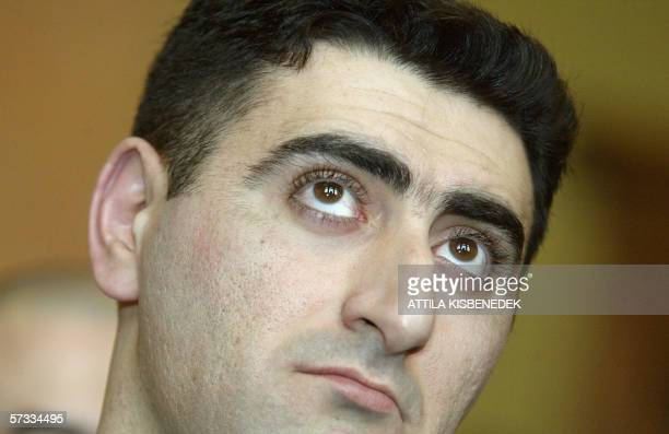 Azerbaijani army officier Lieutenant Ramil Safarov looks upwards as he listens to the verdict 13 April 2006 a conviction of life imprisonment for...