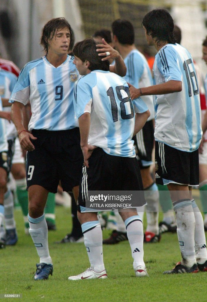 In his first match in the national team, Argentine Lionel Messi (C) is comforted by his teammates Hernan Crespo (R) and Luis Gonzales (R) as he received a red card in the minute after his change in 'Puskas' stadium in Budapest 17 August 2005 during the secodf half of a friendly match between Argentina and Hungary.