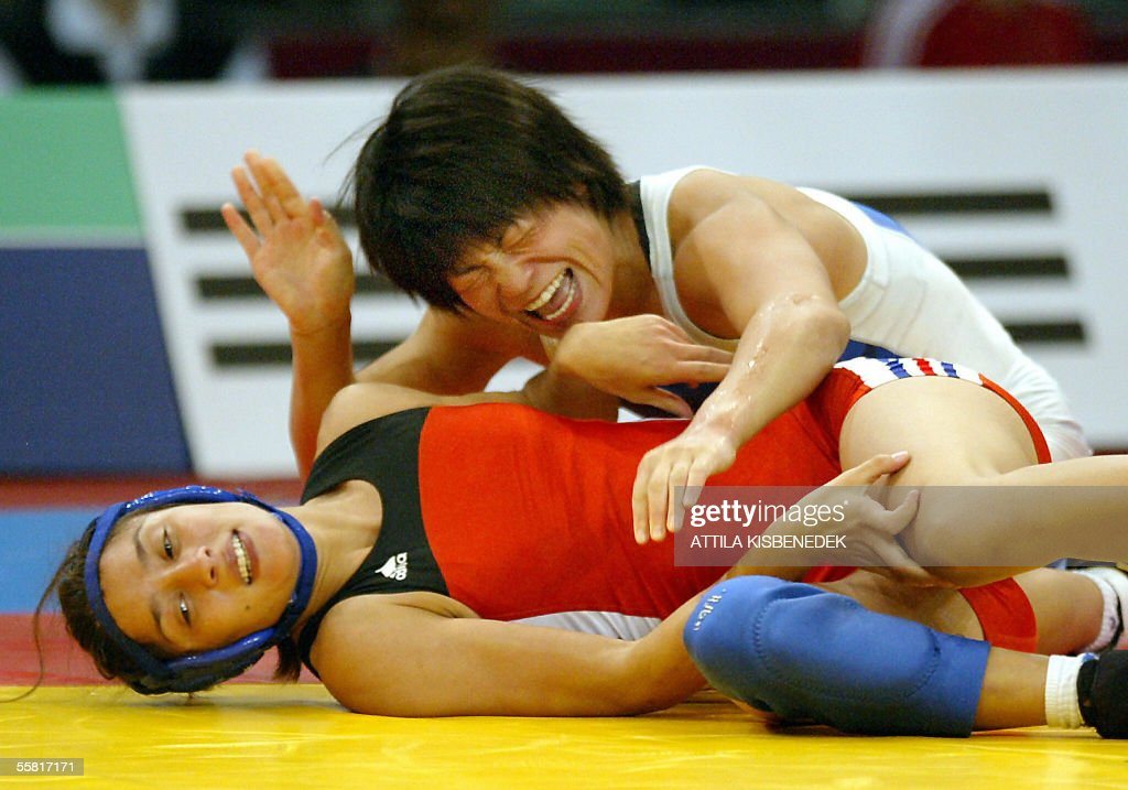 Japanese Hitomi Sakamoto celebrates her gold medal after a winning against French Vanessa Boubryemm after their free style 51 kg category final of...