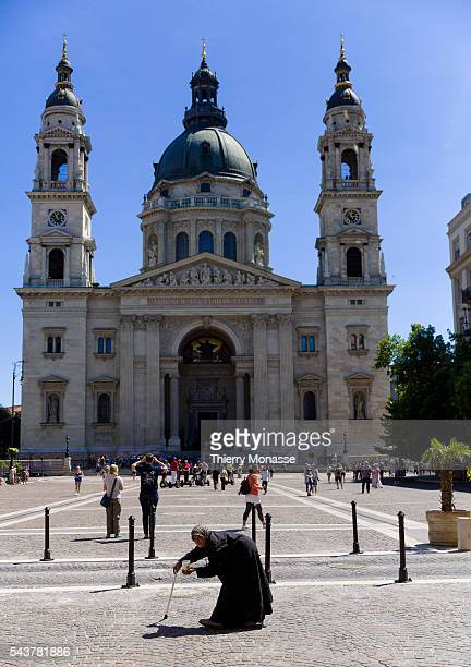 Budapest Hungary July 11 2015 A woman is begging in front of the Saint Stephen's Basilica a Roman Catholic basilica named in honour of Stephen the...