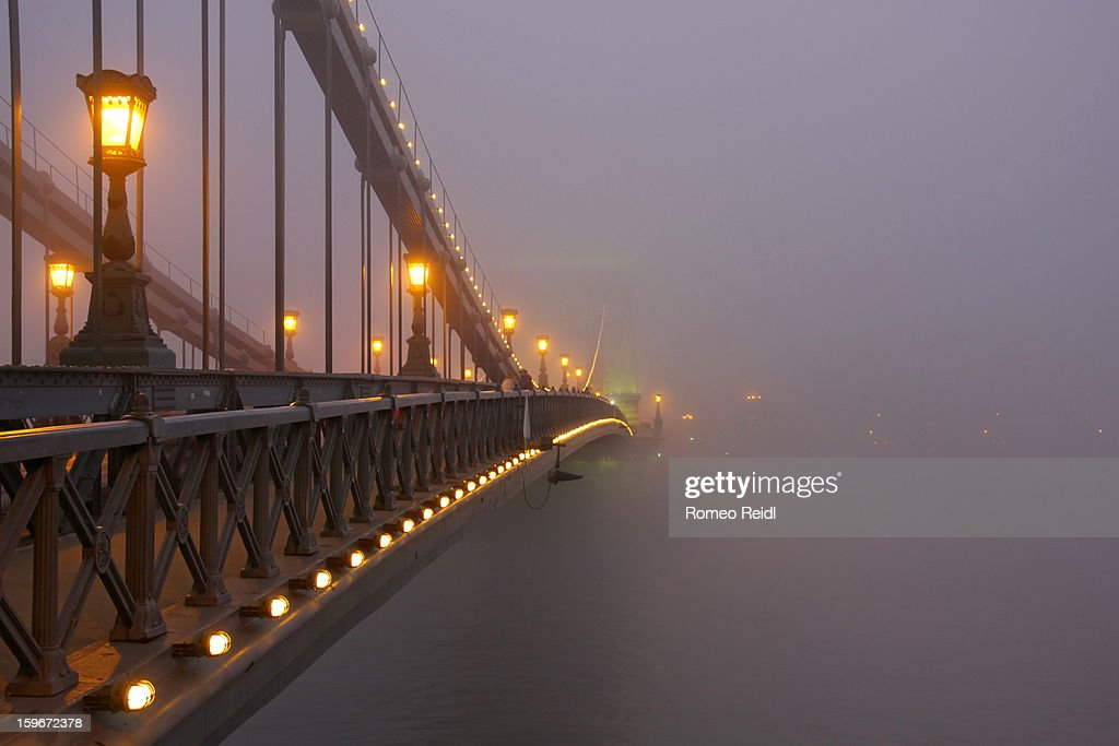 Budapest - the Chain bridge covered in fog at dusk : Stock Photo