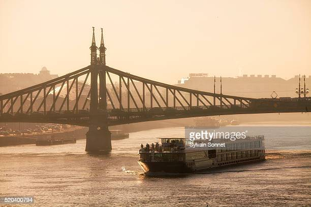 Budapest, Tour Boat on Danube River and Freedom Bridge at Sunris