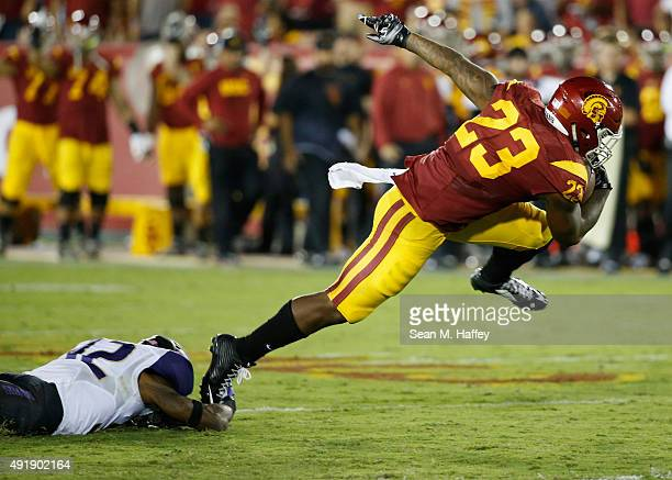 Budda Baker of the Washington Huskies can't get his hand on Tre Madden of the USC Trojans in the first half of a game at Los Angeles Memorial...